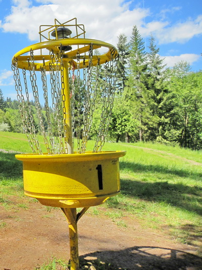 Disc golf basket, photo from EvanLovely on Flicker, through a share license.