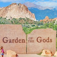 Audrey contemplating the Garden of the Gods sign.