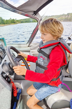 Alida gets to drive the boat.