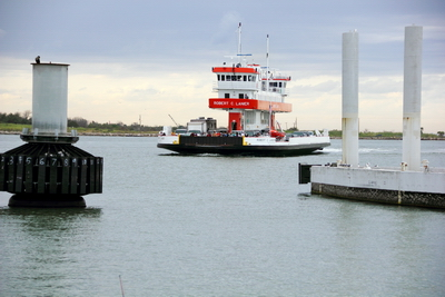 One of the Galveston Ferry's, ran by the Texas DOT arriving to port.