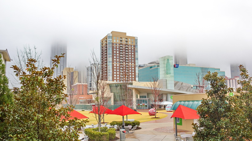 Misty Atlanta, GA, Coca Cola museum park shared with the Aquarium.