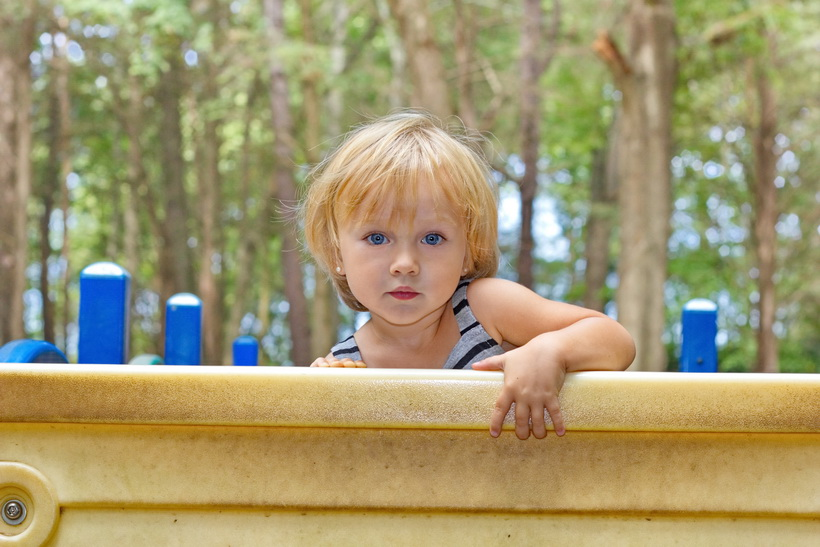 Grandduaghter climbing a wall at the park.